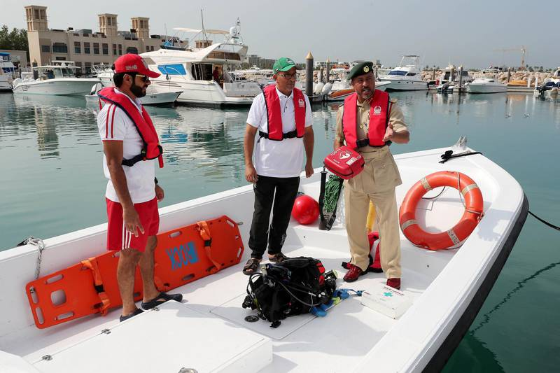 DUBAI , UNITED ARAB EMIRATES , November 26  – 2018 :- Lt. Colonel Ali Abdullah Al Qaseeb Al Naqbi , Head of the Maritime Rescue ( right ) explaining about the rescue equipment at the Fishermen village in Jumeirah in Dubai. ( Pawan Singh / The National ) For News. Story by Salam
