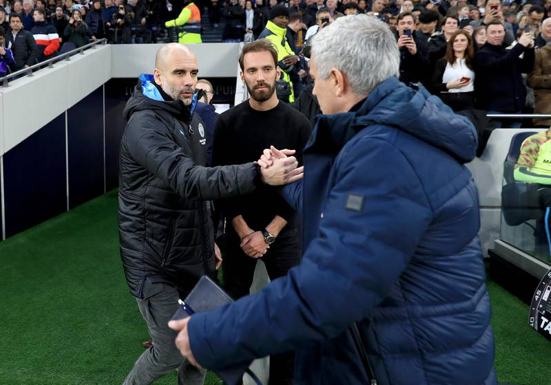 LONDON, ENGLAND - FEBRUARY 02: Jose Mourinho, Manager of Tottenham Hotspur greets Pep Guardiola, Manager of Manchester City prior to the Premier League match between Tottenham Hotspur and Manchester City at Tottenham Hotspur Stadium on February 02, 2020 in London, United Kingdom. (Photo by Matt McNulty - Manchester City/Manchester City FC via Getty Images)