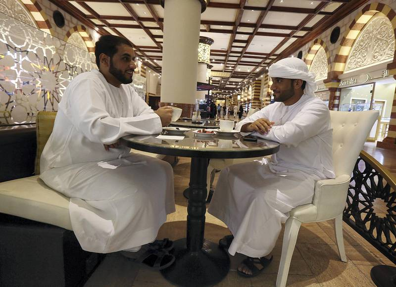 Dubai, May 26, 2018: (L) Mohammed Al Hashmi and (R) Rashed Al Mallah at the coffee shop after the iftar at the Dubai Mall in Dubai. Satish Kumar for the National / Story by Nawal