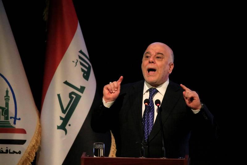 FILE PHOTO: Iraq's Prime Minister Haider al-Abadi speaks during a ceremony in Najaf, Iraq January 7, 2018. REUTERS/Alaa Al-Marjani - /File Photo