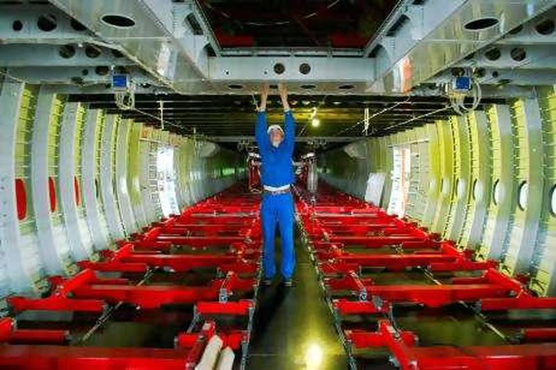 An aircraft mechanic checks the interior of an Airbus A380 at a new test site of the IABG company for the Airbus A380 in Dresden, 05 April 2005. During the following three years, around 47 500 flights of the super-size airliner will be simulated at the new hall to check the world's biggest ever passenger plane's structure and capacity.    AFP PHOTO    DDP/NORBERT MILLAUER    GERMANY OUT