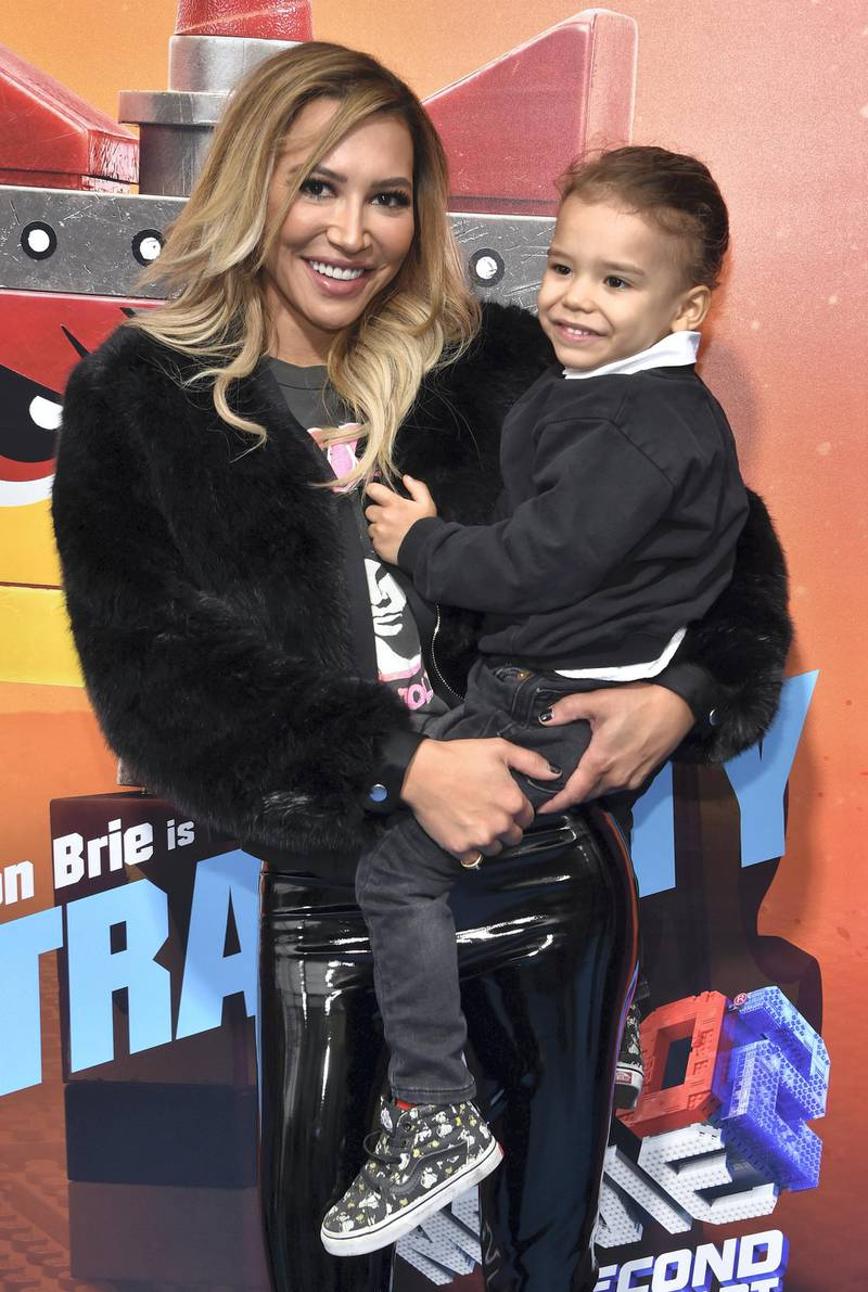 """US actress Naya Rivera and son Josey Hollis Dorsey arrive for the premiere of """"The Lego Movie 2: The Second Part"""" at the Regency Village theatre on February 2, 2019 in Westwood, California. (Photo by Chris Delmas / AFP)"""