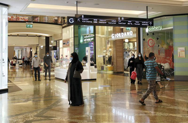 DUBAI, UNITED ARAB EMIRATES , April 29 – 2020 :- Shoppers wearing protective face mask to prevent the spread of the coronavirus at Mall of the Emirates in Dubai. Authorities ease the restriction for the residents in Dubai. At present mall opening timing is 12:00 pm to 10:00 pm. Carrefour timing is 9:00 am to 10:00 pm. (Pawan Singh / The National) For News/Standalone/Online. Story by Patrick