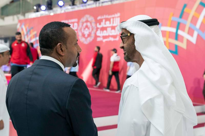 ABU DHABI, UNITED ARAB EMIRATES - March 18, 2019: HH Sheikh Mohamed bin Zayed Al Nahyan, Crown Prince of Abu Dhabi and Deputy Supreme Commander of the UAE Armed Forces (R) and HE Abiy Ahmed, Prime Minister of Ethiopia (L), tour the Special Olympics World Games Abu Dhabi 2019, at Abu Dhabi National Exhibition Centre (ADNEC).  ( Ryan Carter / Ministry of Presidential Affairs )? ---