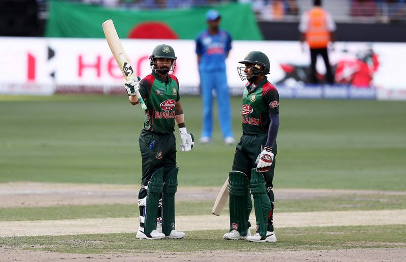 DUBAI , UNITED ARAB EMIRATES, September 28 , 2018 :- Liton Das ( left ) of Bangladesh celebrating after scoring his half century during the final of Unimoni Asia Cup UAE 2018 cricket match between Bangladesh vs India held at Dubai International Cricket Stadium in Dubai. Also seen in the photo on the right side Mehidy Hasan.  ( Pawan Singh / The National )  For News/Sports/Instagram/Big Picture. Story by Paul