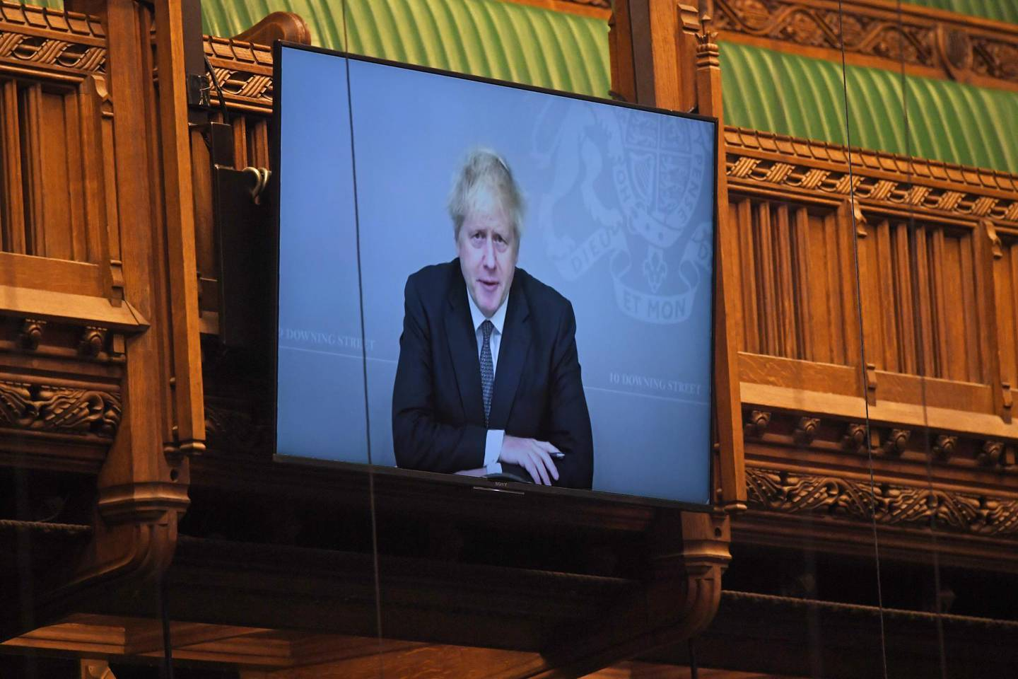 epa08827833 A handout photo made available by the UK Parliament shows Britain's Prime Minister Boris Johnson on a large screen as he takes part virtually in the Prime Minister's Questions (PMQs) in the House of Commons at Parliament in London, Britain, 18 November 2020. British Prime Minister Boris Johnson, who battled a coronavirus infection earlier this year, is self-isolating after having been exposed to the coronavirus again  EPA/JESSICA TAYLOR / UK PARLIAMENT / HANDOUT MANDATORY CREDIT: JESSICA TAYLOR / UK PARLIAMENT HANDOUT EDITORIAL USE ONLY/NO SALES