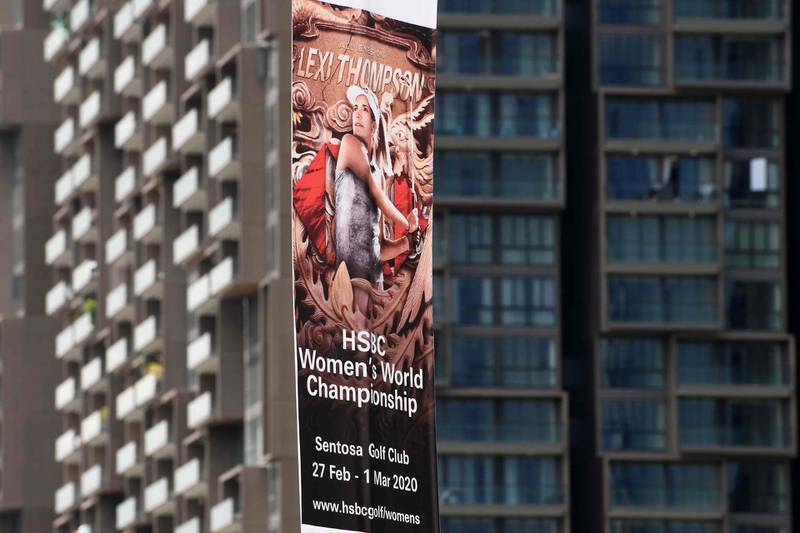 A promotional banner for the upcoming HSBC Women's World Championship, which was cancelled due to concerns about the novel coronavirus, is displayed in the financial district in Singapore on February 10, 2020. Golf's HSBC Women's World Championship in Singapore later this month was cancelled on February 10 as was next week's LPGA Thailand tournament, meaning the US women's Tour has now lost all three of their lucrative early-season events in Asia. / AFP / Roslan RAHMAN