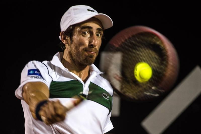 Pablo Cuevas of Uruguay returns a shot to Rafael Nadal of Spain during their men's singles semi-final match of the 2016 Rio Open tennis tournament in Rio de Janeiro, Brazil, on Februrary 20, 2016. AFP PHOTO / YASUYOSHI CHIBA (Photo by YASUYOSHI CHIBA / AFP)