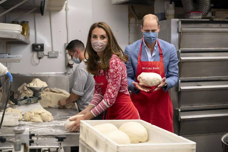 LONDON, ENGLAND - SEPTEMBER 15: Prince William, Duke of Cambridge and Catherine, Duchess of Cambridge knead dough during a visit to Beigel Bake Brick Lane Bakery on September 15, 2020 in London, England. The 24-hour bakery was forced to reduce their opening hours during the pandemic and The Duke and Duchess heard how this affected employees, as well as the ways in which the shop has helped the local community through food donation and delivery. (Photo by Justin Tallis - WPA Pool/Getty Images)