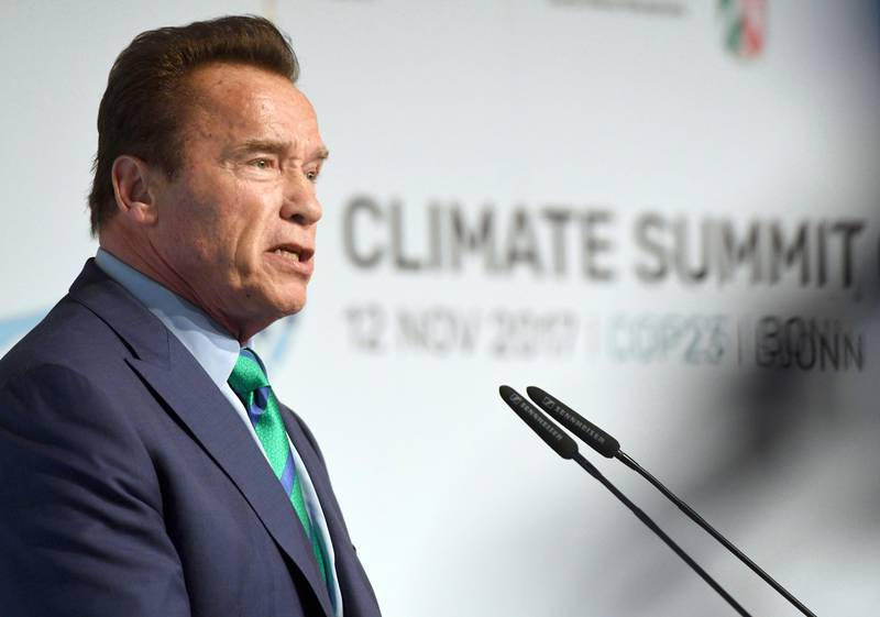 """Former governor of California Arnold Schwarzenegger talks in the """"Bonn-Zone"""" during the World Climate Conference in Bonn, Germany, Sunday Nov. 12, 2017.  During the summit, cities and regions emphasize that climate protection is not only an issue for national governments. (Henning Kaiser/dpa via AP)"""