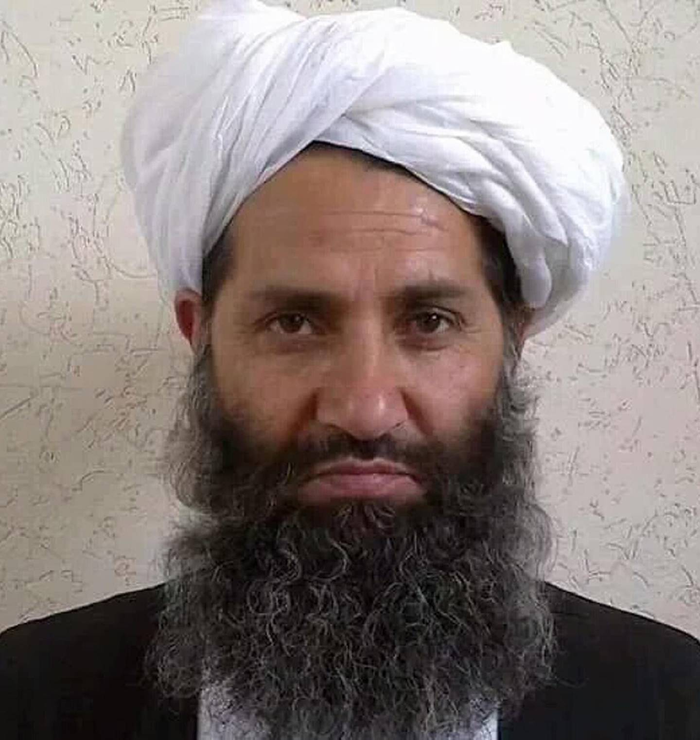 """This undated handout photograph released by the Afghan Taliban on May 25, 2016 shows, according to the Afghan Taliban, the new Mullah Haibatullah Akhundzada posing for a photograph at an undisclosed location. - The Afghan Taliban on May 25 announced Haibatullah Akhundzada as their new chief, elevating a low-profile religious figure in a swift power transition after officially confirming the death of Mullah Mansour in a US drone strike. (Photo by STR / Afghan Taliban / AFP) / -----EDITORS NOTE --- RESTRICTED TO EDITORIAL USE - MANDATORY CREDIT """"AFP PHOTO / AFGHAN TALIBAN"""" - NO MARKETING - NO ADVERTISING CAMPAIGNS - DISTRIBUTED AS A SERVICE TO CLIENTS"""