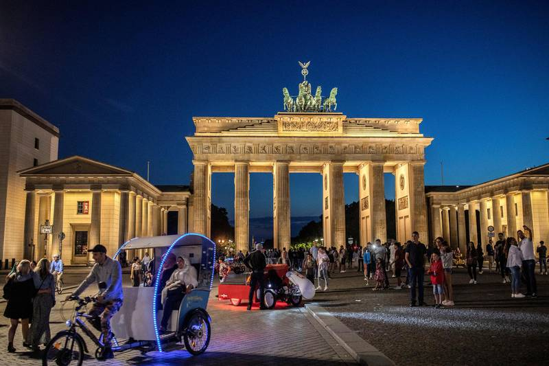 BERLIN, GERMANY - JULY 24: Tourists gather at the Brandenburg gate in Berlin on July 24, 2020 in Berlin, Germany. For the German capital, the COVID-19 pandemic has been economically devastating, as its liveihood depends on partygoers and tourism.  (Photo by Maja Hitij/Getty Images)