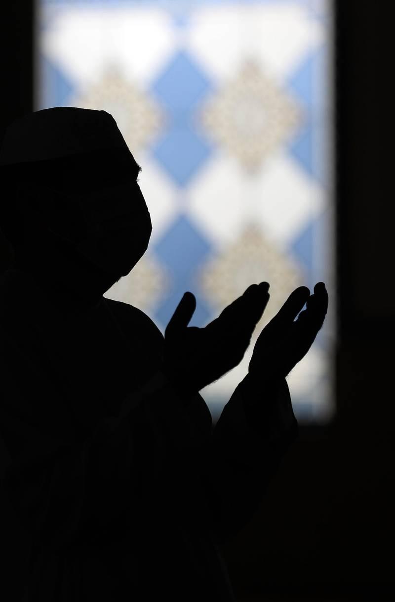 Dubai, United Arab Emirates - December 03, 2020: A man prays at Al Farooq Omar Bin Al Khattab Mosque. Thursday, December 3rd, 2020 in Dubai. Chris Whiteoak / The National