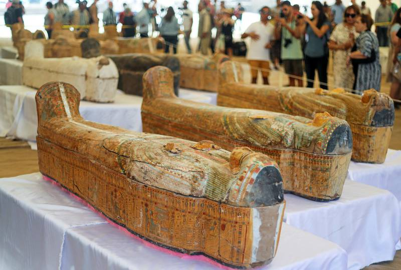 Tourists look at painted ancient coffins at Al-Asasif necropolis, unveiled by Egyptian antiquities officials in the Valley of the Kings in Luxor, Egypt October 19, 2019. REUTERS/Mohamed Abd El Ghany