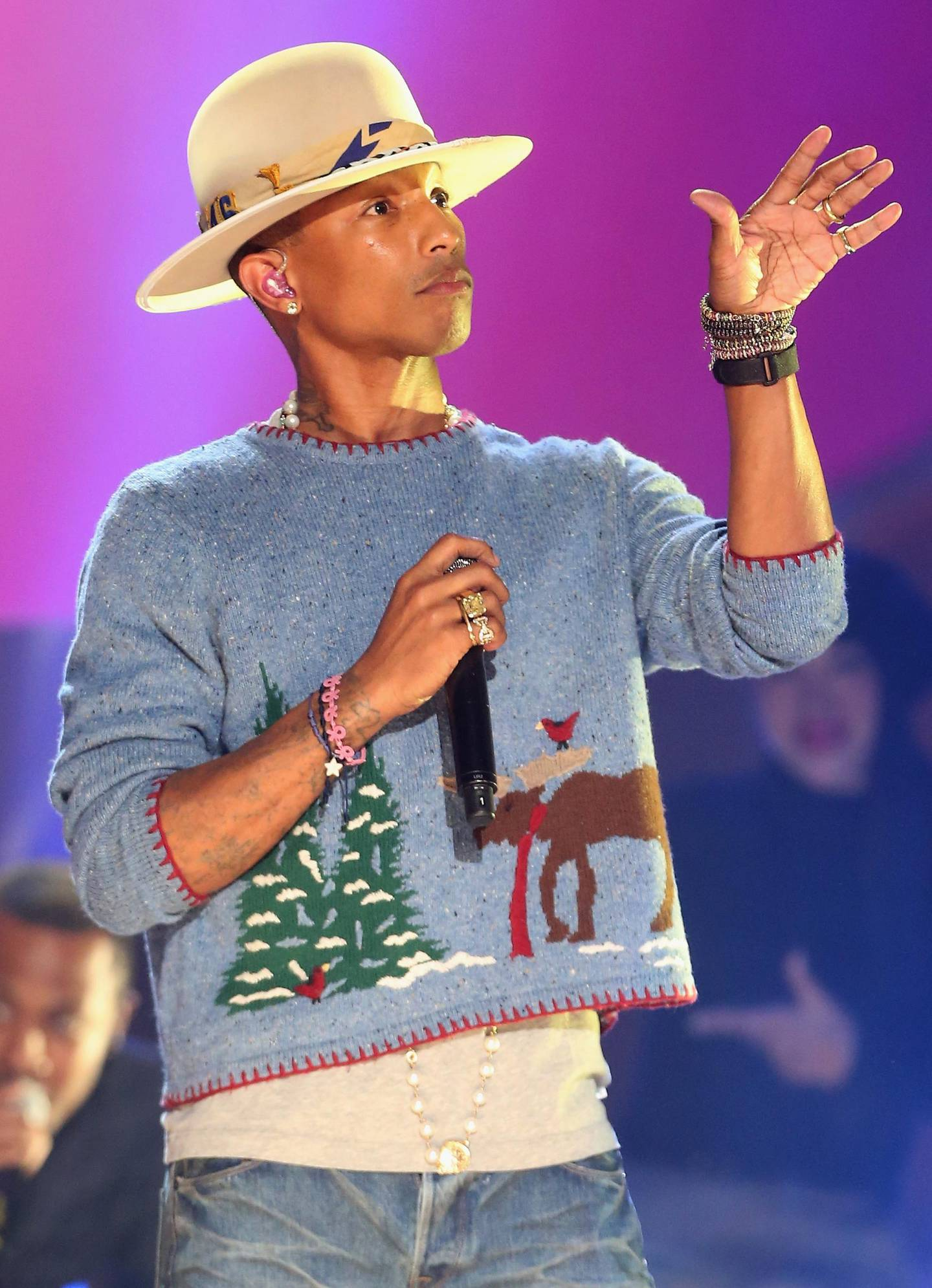 LOS ANGELES, CA - NOVEMBER 18:  Musician Pharrell Williams performs onstage during A VERY GRAMMY CHRISTMAS at The Shrine Auditorium on November 18, 2014 in Los Angeles, California.  (Photo by Frederick M. Brown/Getty Images)