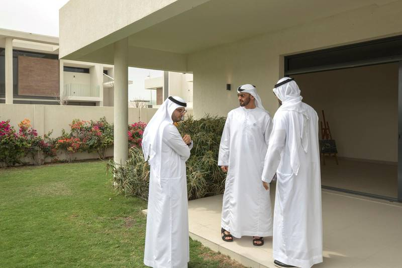 YAS ISLAND, ABU DHABI, UNITED ARAB EMIRATES -March 01, 2018: HH Sheikh Mohamed bin Zayed Al Nahyan, Crown Prince of Abu Dhabi and Deputy Supreme Commander of the UAE Armed Forces (2nd L), inspects urban development and tourism projects, at West Yas. Seen with HE Mohamed Khalifa Al Mubarak, Chairman of the Department of Culture and Tourism and Abu Dhabi Executive Council Member (R - face not shown).   ( Hamad Al Mansouri for Crown Prince Court - Abu Dhabi )  ---