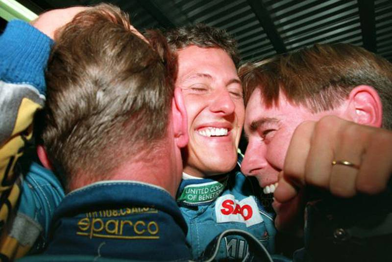 13 NOV 1994:  GERMANY's MICHAEL SCHUMACHER CELEBRATES WITH BENETTON MECHANICS ON HIS RETURN TO THE PITS AFTER BECOMING FORMULA ONE WORLD CHAMPION AT THE AUSTRALIAN GRAND PRIX, ADELAIDE. Mandatory Credit: Mike Hewitt/ALLSPORT