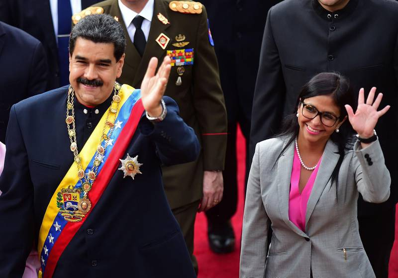 (FILES) In this file picture taken on August 10, 2017 Venezuelan President Nicolas Maduro (L) arrives at the Congress with (then) head of the Constituent Assemby, Delcy Rodriguez (R) to address the all-powerful pro-Maduro assembly which has been placed over the National Assembly and tasked with rewriting the constitution, in Caracas. Venezuelan President Nicolas Maduro announced on June 14, 2018 in his Twitter account several changes in his government, highlighting the appointment of Delcy Rodriguez, one of his closest allies, as vice-president, replacing Tareck El Aissami. / AFP / Ronaldo SCHEMIDT