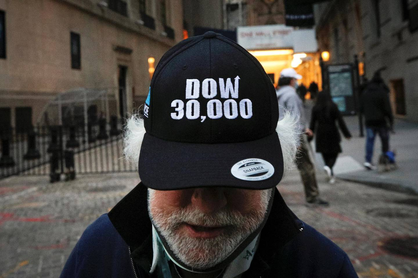 Trader Peter Tuchman wears a DOW 30,000 hat as he greets friends outside the New York Stock Exchange (NYSE) in New York, U.S., November 24, 2020. REUTERS/Brendan McDermid