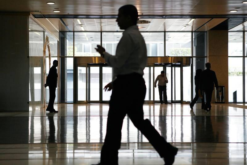 Dubai, Jan 16th, 2012 --  DIFC STOCK - Business men walk at DIFC.  Photo by: Sarah Dea/ The National