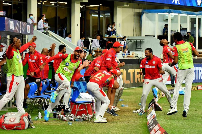 Kings XI Punjab Coach Anil Kumble and whole team at the dugout jumps with joy sand celebrates win over Mumbai Indians during match 36 of season 13 of the Dream 11 Indian Premier League (IPL) between the Mumbai Indians and the Kings XI Punjab held at the Dubai International Cricket Stadium, Dubai in the United Arab Emirates on the 18th October 2020.  Photo by: Samuel Rajkumar  / Sportzpics for BCCI