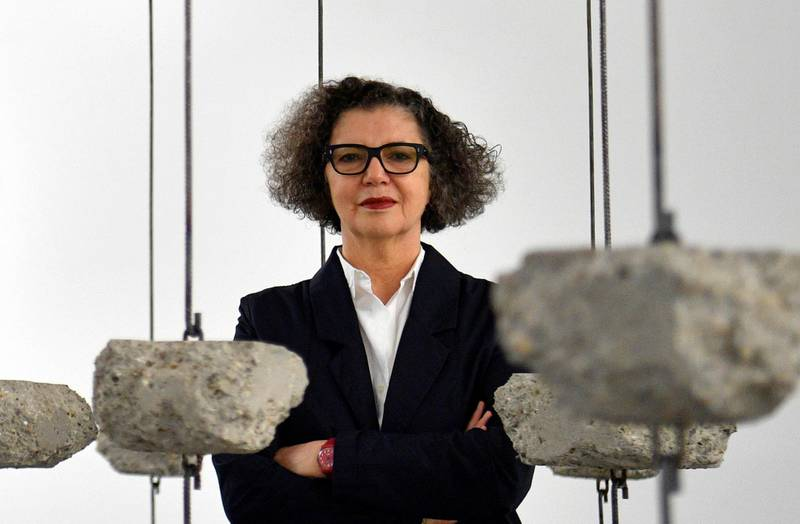 epa07848660 (FILE) - Palestinian-British artist Mona Hatoum poses with her artwork 'Remains to be Seen' as part of a multi-artist show at the White Cube Bermondsey in London, Britain, 11 September 2019 (reissued 17 September 2019). Mona Hatoum was announced as one of the five winners of the 2019 Praemium Imperiale Awards in the category 'Sculpture'. The Japan Art Association named the recipients of the global arts prize on 17 September.  EPA/NEIL HALL