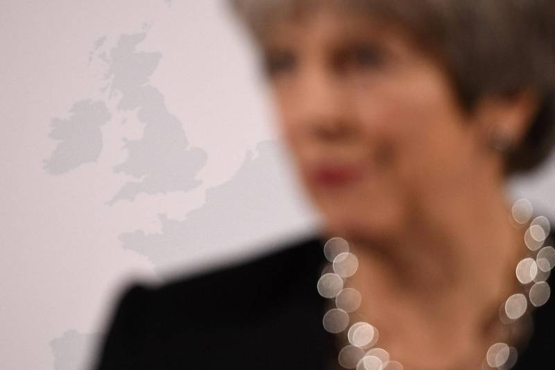 FILE PHOTO: Britain's Prime Minister Theresa May stands in front of an image of the UK as she delivers a speech about her vision for Brexit, at Mansion House in London, Britain, March 2, 2018.  To match Special Report BRITAIN-EU/MAY    Leon Neal/Pool via REUTERS/File Photo