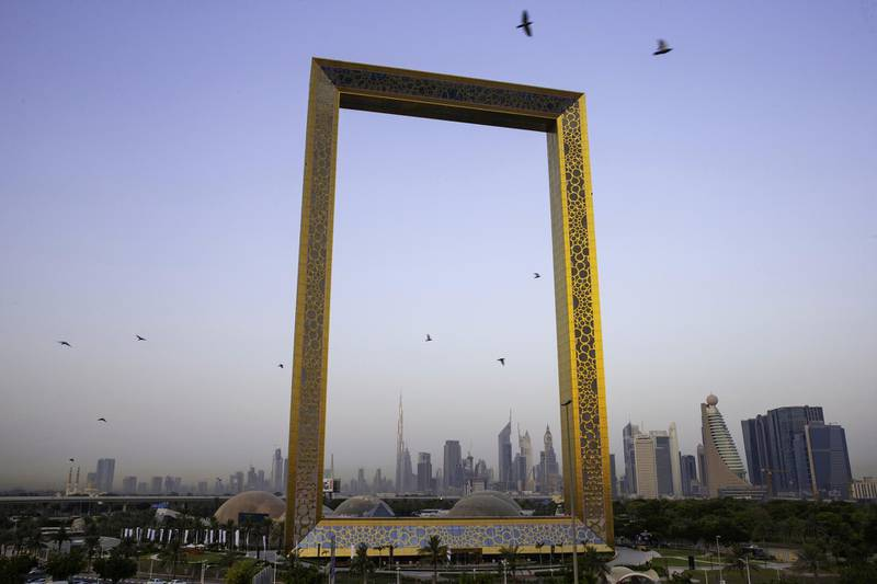 The Burj Khalifa skyscraper, center left, stands above the city skyline seen through the Dubai Frame architectural landmark in Dubai, United Arab Emirates, on Tuesday, June 19, 2018. Since the 1970s, Dubai has invested heavily in construction and infrastructure, creating a global center for finance, real estate and tourism. Photographer: Christopher Pike/Bloomberg