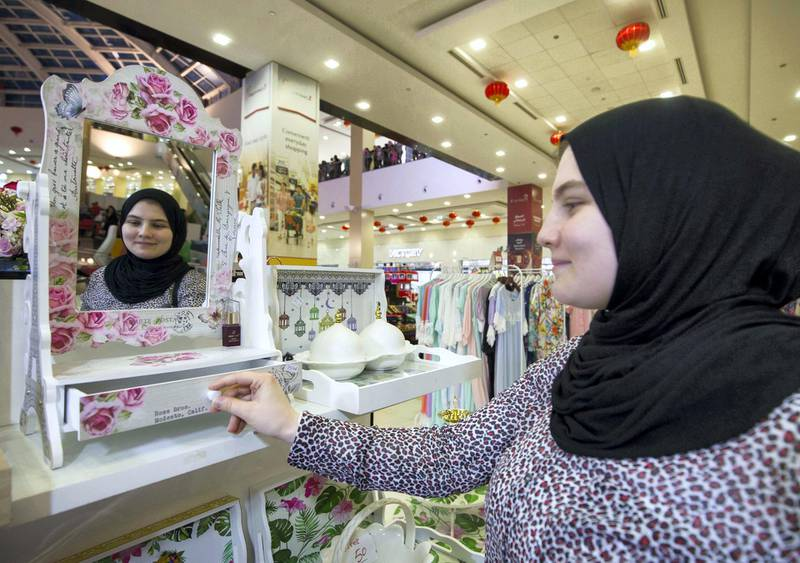 DUBAI, UNITED ARAB EMIRATES, 04 May 2018 - A shopper checking out an item at Ramadan Market, Dragon Mart 2.  Leslie Pableo for The National for Ellen Fortini's story