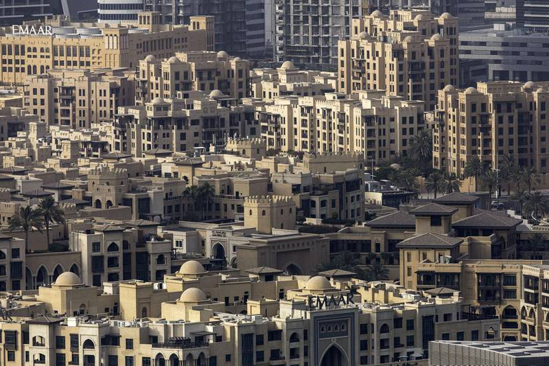 Residential properties stand in the Old Town Island area, developed by Emaar Properties PJSC, in Dubai, United Arab Emirates, on Tuesday, July 23, 2019. Like the rest of the city, the business center has suffered from a prolonged real-estate slump brought on by oversupply and slower economic growth. Photographer: Christopher Pike/Bloomberg
