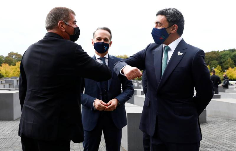 UAE Foreign Minister Sheikh Abdullah bin Zayed al-Nahyan and his Israeli counterpart Gabi Ashkenazi greet as they visit the Holocaust memorial together with German Foreign Minister Heiko Maas prior to their historic meeting in Berlin, Germany October 6, 2020.  REUTERS/Michele Tantussi