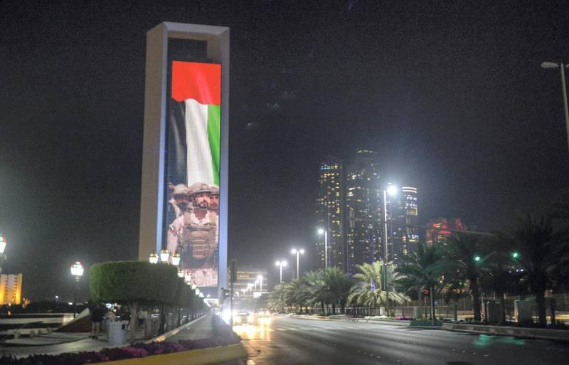 Abu Dhabi, United Arab Emirates - ADNOC building projected with the image of Sheikh Zayed Bin Hamdan on February 17, 2018. (Khushnum Bhandari/ The National)