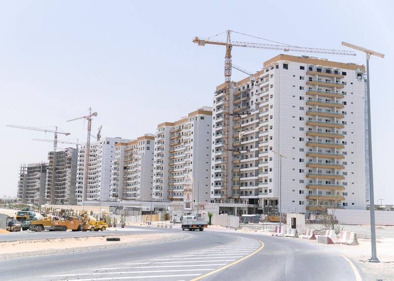 DUBAI, UNITED ARAB EMIRATES - JULY 15 2019.The entrance road to Living Legends still under construction.Some residents and investors of Living Legends have paid Dh6m for villas, and pay Dh25,000 a year in service charges but the development still looks like a construction site, with an unfinished golf course, roads, open sewer works near the school, poor lighting and no desert boundary meaning dangerous snakes and animals are regularly getting into the gardens and villas. (Photo by Reem Mohammed/The National)Reporter: NICK WEBSTERSection: NA