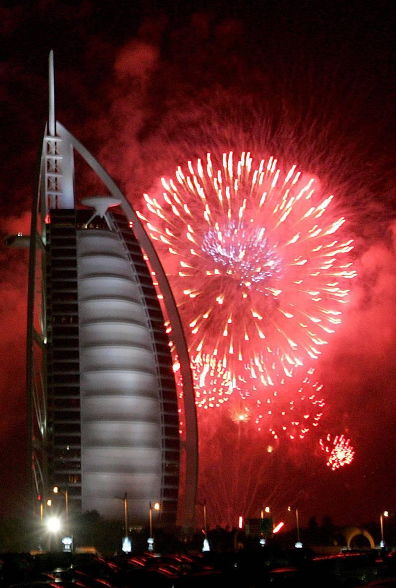 DUBAI, UNITED ARAB EMIRATES – January 1: Fireworks display near the Burj Al Arab hotel on January 1, 2008 to welcome the New Year in Dubai. (Photo by Pawan Singh /Abu Dhabi Media Company)