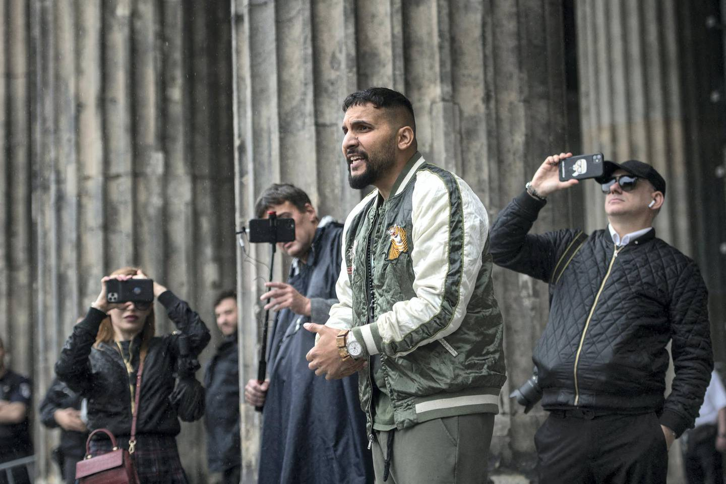 German vegan cookbook author and conspiracy theorist Attila Hildmann speaks during a protest against restrictions implemented in order to limit the spread of the novel coronavirus / COVID-19 pandemic  in front of Altes Museum in Berlin, on June 20, 2020. (Photo by Stefanie LOOS / AFP)