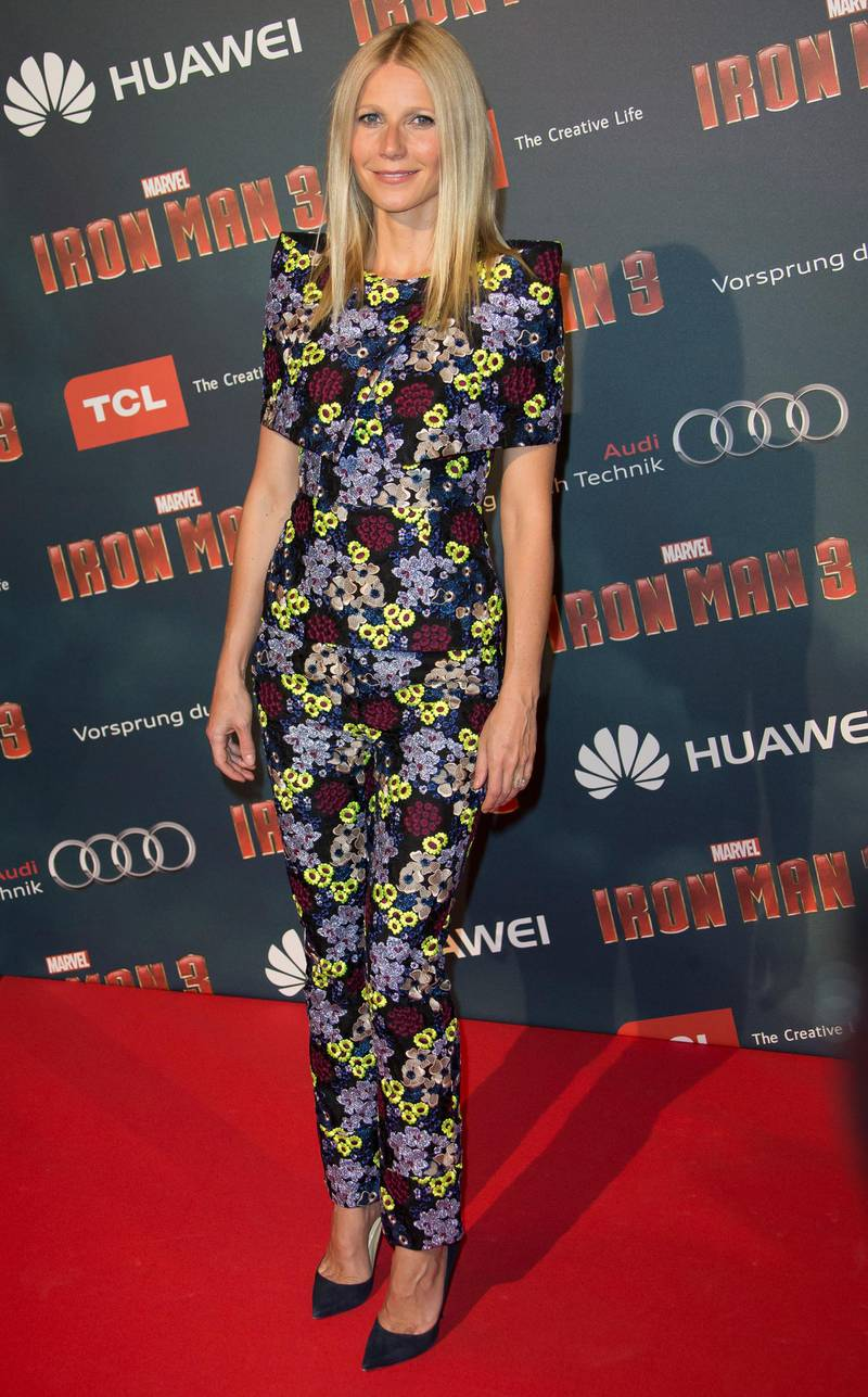 epa03662177 US actress and cast member Gwyneth Paltrow poses for photographers during the premiere of the film 'Iron Man 3' at the Grand Rex theatre in Paris, France, 14 April 2013. The film will be released on 24 April in France.  EPA/IAN LANGSDON
