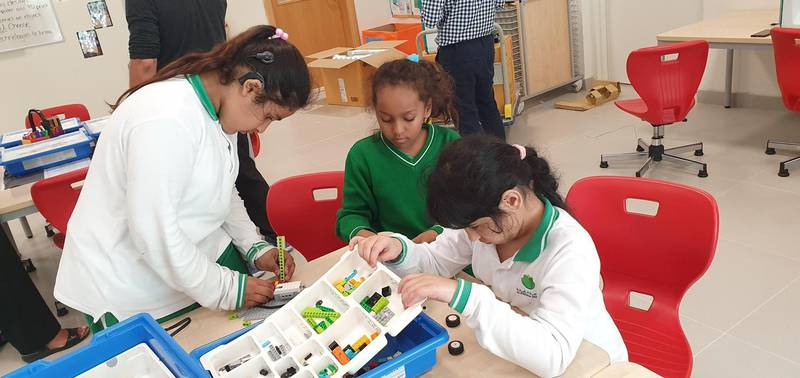 Children work together at Special Olympics UAE's Unified Robotics 2019, a programme geared to introduce children who have special needs to robotics. Courtesy: Special Olympics UAE