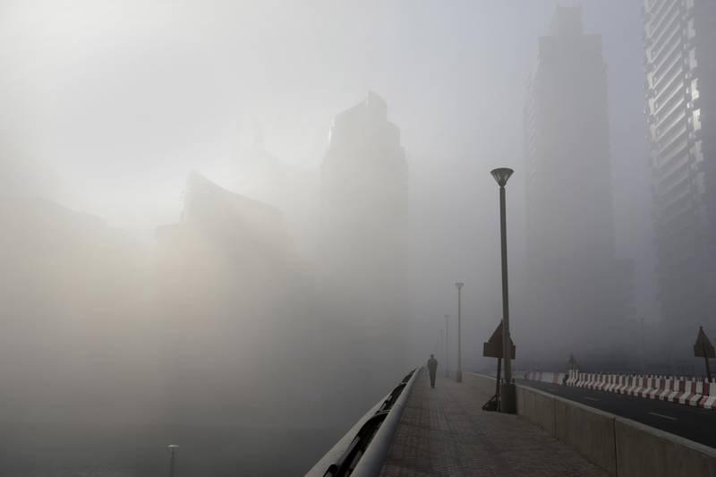 Dubai, United Arab Emirates, Mar 06, 2014 - Early morning fog at Dubai Marina. ( Jaime Puebla / The National Newspaper ) Focal Point