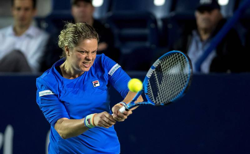 epa08268307 Kim Clijsters of Belgium in action against Johanna Konta of Britain during the women's singles match at the Monterrey Open tennis tournament in Monterrey, Mexico, 03 March 2020.  EPA/MIGUEL SIERRA