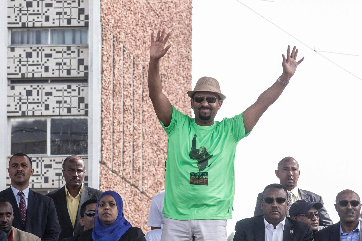 Ethiopia Prime Minister Abiy Ahmed waves to the crowd during a rally on Meskel Square in Addis Ababa on June 23, 2018. A blast at a rally in Ethiopia's capital today in support of new Prime Minister Abiy Ahmed killed several people, state media quoted the premier as saying. / AFP / YONAS TADESE
