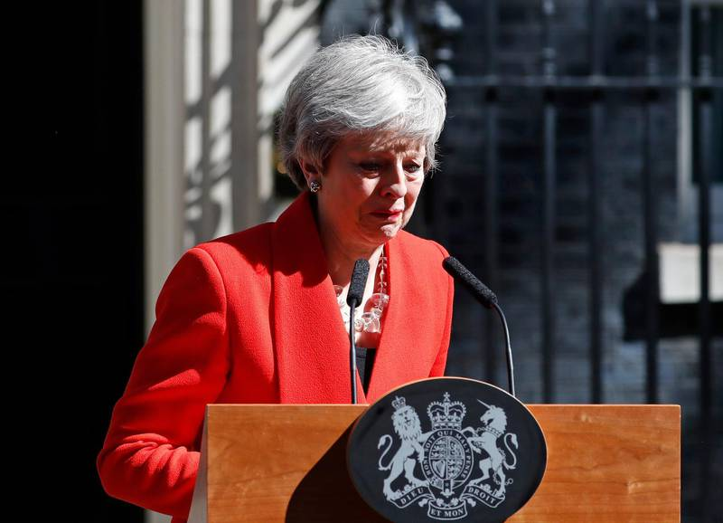 FILE - In this Friday, May 24, 2019 file photo British Prime Minister Theresa May reacts as she turns away after making a speech, saying that she would step down, in the street outside 10 Downing Street in London, England. Britain and the European Union have struck a provisional free-trade agreement that should avert New Year��������s chaos for cross-border commerce and bring a measure of certainty to businesses after years of Brexit turmoil. The breakthrough on Thursday, Dec. 24, 2020 came after months of tense and often testy negotiations that whittled differences down to three key issues: fair-competition rules, mechanisms for resolving future disputes and fishing rights. (AP Photo/Alastair Grant, File)