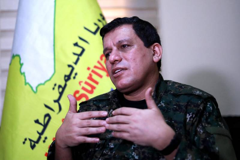 """Mazloum Kobani, commander-in-chief of the Syrian Democratic Forces (SDF), speaks with AFP during an interview in the countryside outside the northwestern Syrian city of Hasakah, in the province of the same name, on January 24, 2019. Any deal between Syria's Kurds and the Damascus regime should respect the """"special status"""" of Kurdish-led forces who fought the Islamic State (IS) group, Kobani said. The SDF control around a third of Syria after expelling jihadists from a large northeastern swathe of the war-torn country with backing from the US-led coalition. / AFP / Delil SOULEIMAN"""