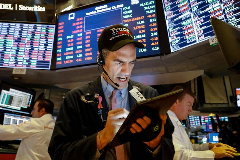 Traders work on the floor at the New York Stock Exchange (NYSE) in New York, U.S., September 17, 2019. REUTERS/Brendan McDermid