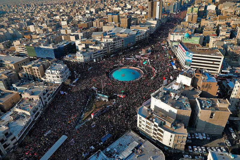 In this aerial photo released by an official website of the office of the Iranian supreme leader, mourners attend a funeral ceremony for Iranian Gen. Qassem Soleimani and his comrades, who were killed in Iraq in a U.S. drone strike on Friday, in Tehran, Iran, Monday, Jan. 6, 2020. The processions mark the first time Iran honored a single man with a multi-city ceremony. Not even Ayatollah Ruhollah Khomeini, who founded the Islamic Republic, received such a processional with his death in 1989. (Office of the Iranian Supreme Leader via AP)