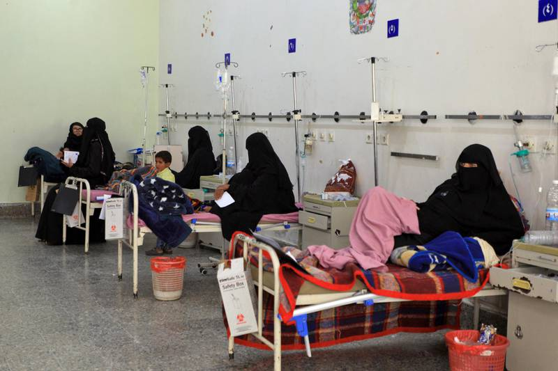 """Women sit with their children receiving treatment at al-Sabeen Maternity and Child Hospital in the Yemeni capital Sanaa, on September 19, 2020. - Human Rights Watch warned of """"deadly consequences"""" as a result of the obstruction of aid in war-torn Yemen, where the humanitarian effort has already been badly hit by the coronavirus crisis. Interviews with 35 humanitarian workers, 10 donor officials and 10 Yemeni health workers revealed a complex web of restrictions that hinder the flow of aid. (Photo by Mohammed HUWAIS / AFP)"""