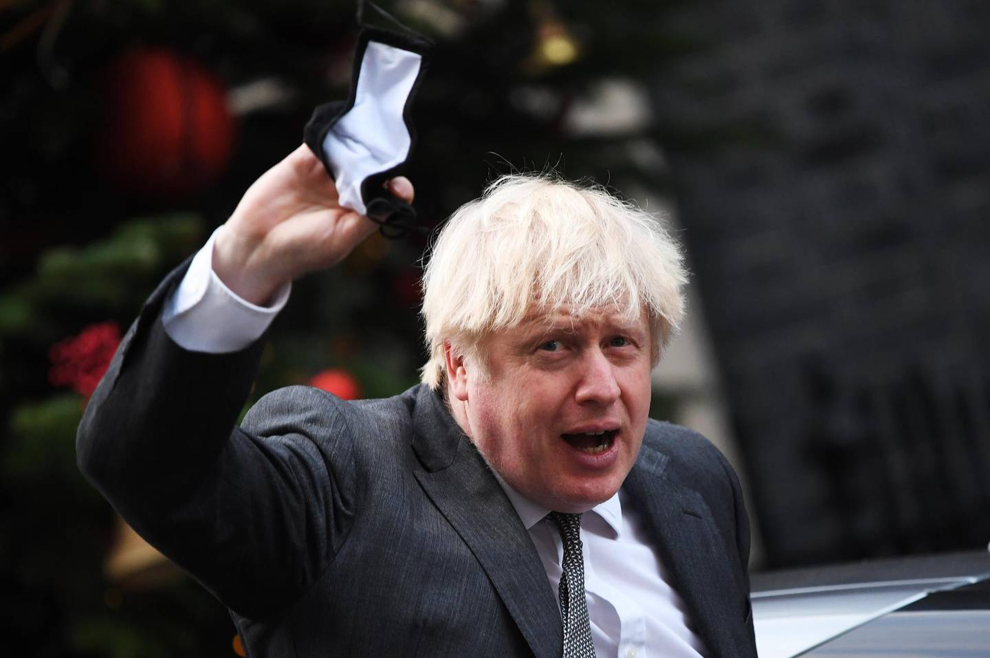 LONDON, ENGLAND - DECEMBER 30: Prime Minister Boris Johnson returns to No.10 Downing Street after MPs approved the EU-UK Brexit trade deal by 521 votes to 73 at its first stage in the House of Commons on December 30, 2020 in London, England. The United Kingdom and the European Union agreed a Trade and Cooperation Agreement, an Agreement on Nuclear Cooperation and an Agreement on Security Procedures for Exchanging and Protecting Classified Information on Christmas Eve 2020.  These Agreements change the basis of the UK's relationship with the EU from EU law to free trade and friendly cooperation. In a referendum of 23 June 2016 the British people voted to take back control of their laws, borders, money, trade and fisheries, commonly referred to as Brexit. (Photo by Chris J Ratcliffe/Getty Images)