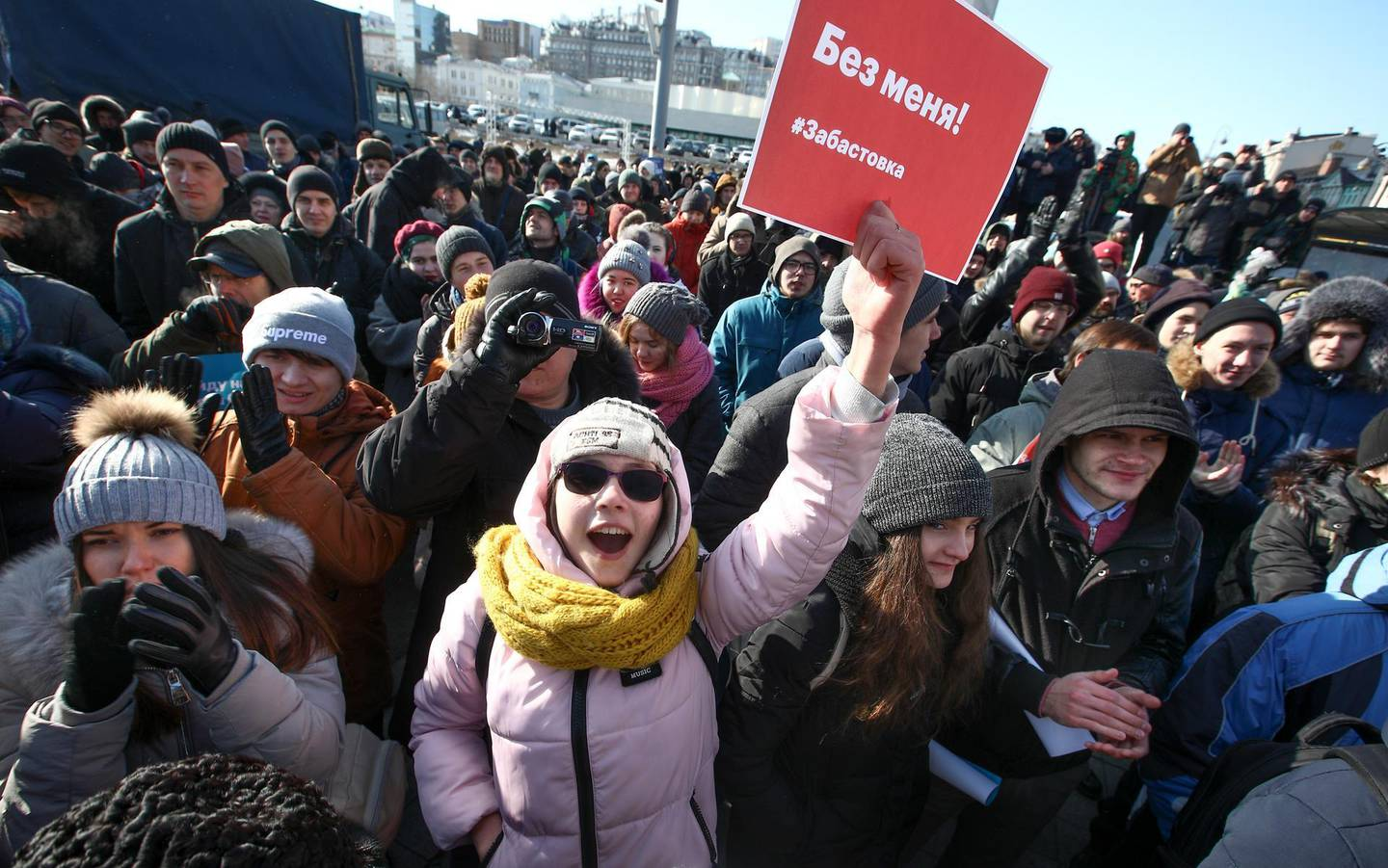 """Demonstrators shout slogans holding a poster which reads """"Elections without me! Strike."""" during a rally in Vladivostok, Russia, Sunday, Jan. 28, 2018. Opposition politician Alexey Navalny calls for nationwide protests following Russia's Central Election Commission's decision to ban his presidential candidacy. (AP Photo/Aleksander Khitrov)"""