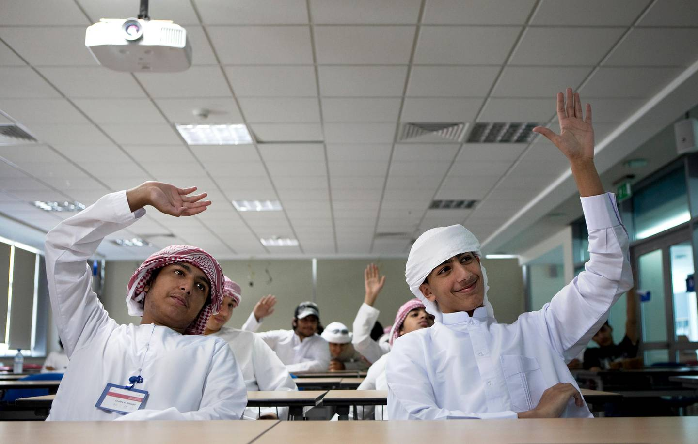 Right to left, Khalifa al Naqbi, 17, and Yusuf al Kendi, react to a question in 'Technology Business Incubation' lecture on Monday, July 11, 2011, the second day of a three-week-long summer camp for the Emirati youth at the Glenelg Primary School in Abu Dhabi. The program, run by the American University of Sharja in association with ATIC, aims to raise interest among the young Emiratis in the semiconductor microelectronics technology and the industry, and thus invest in the UAE's future, post-oil economy.  (Silvia Razgova/The National)