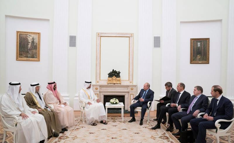 MOSCOW, RUSSIA - June 01, 2018: HH Sheikh Mohamed bin Zayed Al Nahyan, Crown Prince of Abu Dhabi and Deputy Supreme Commander of the UAE Armed Forces (4th L), meets HE Vladimir Putin Vladimirovich, President of Russia (5th R), at the Kremlin Palace. Seen with HE Khaldoon Khalifa Al Mubarak, CEO and Managing Director Mubadala, Chairman of the Abu Dhabi Executive Affairs Authority and Abu Dhabi Executive Council Member (L), HE Dr Anwar bin Mohamed Gargash, UAE Minister of State for Foreign Affairs (2nd L), HH Sheikh Tahnoon bin Zayed Al Nahyan, UAE National Security Advisor (3rd L), HE Sergey Lavrov Minister of Foreign Affairs of Russia (3rd R) and HE Denis Manturov, Minister of Industry and Trade of Russia (R).  ( Mohamed Al Hammadi / Crown Prince Court - Abu Dhabi ) ---