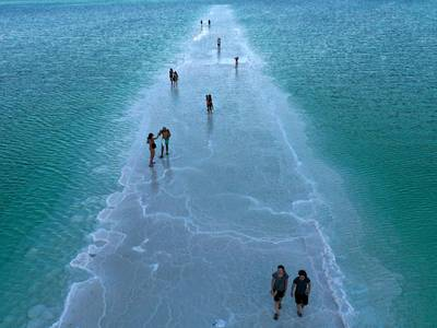 Sinkholes on receding Dead Sea shore mark 'nature's revenge' - in pictures